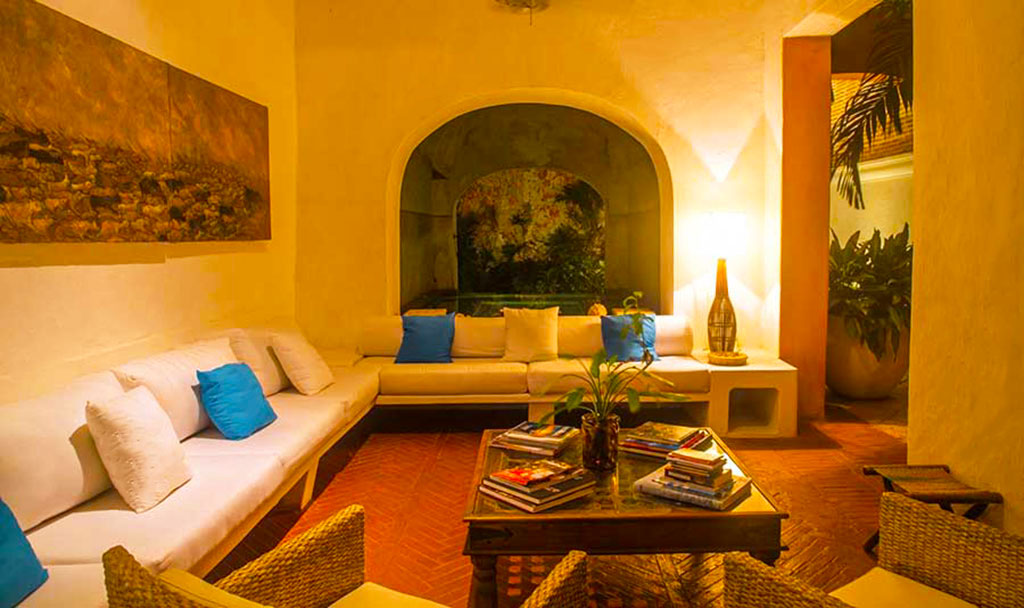 Luxury Home Rental Cartagena Casa La Palmera sitting room in the evening